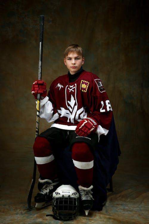 Boy in Red Ice Hockey Gear