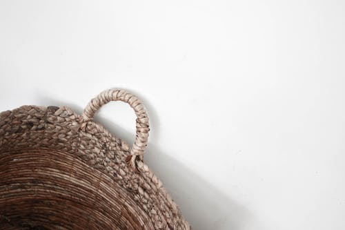Brown Woven Basket on White Table