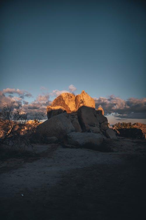 Foto stok gratis alam, awan, backlit, batu