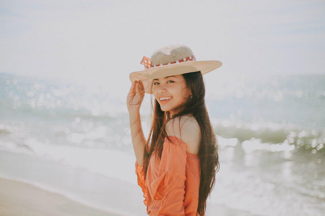Selective Focus Photography of Smiling Girl Near Beach