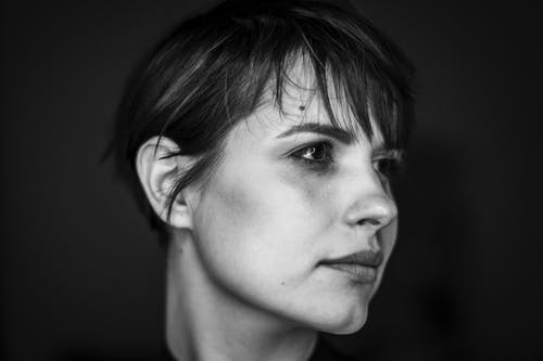 Grayscale Photo of Woman With Short Hair