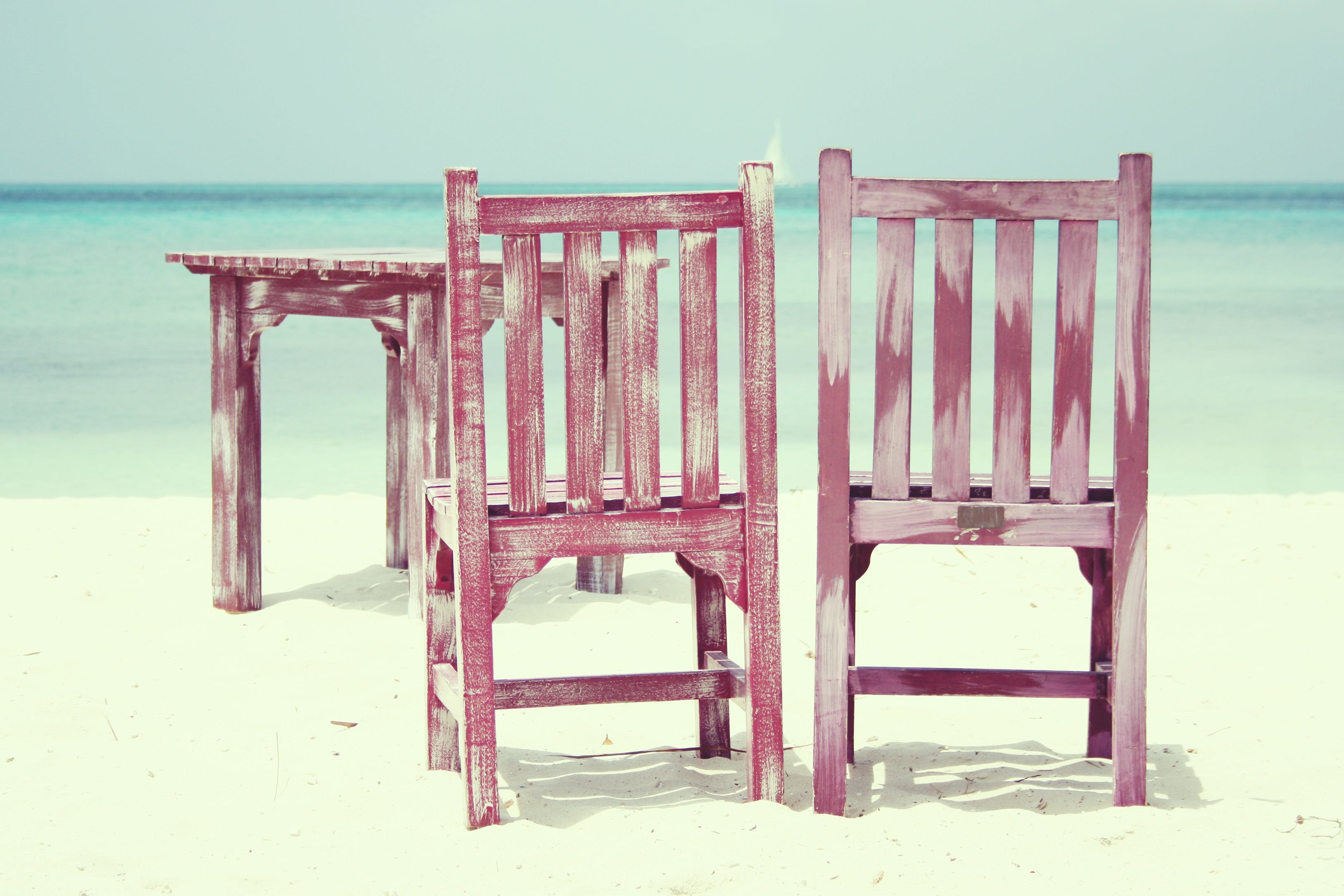 Table and Two Chairs on Beach Shore
