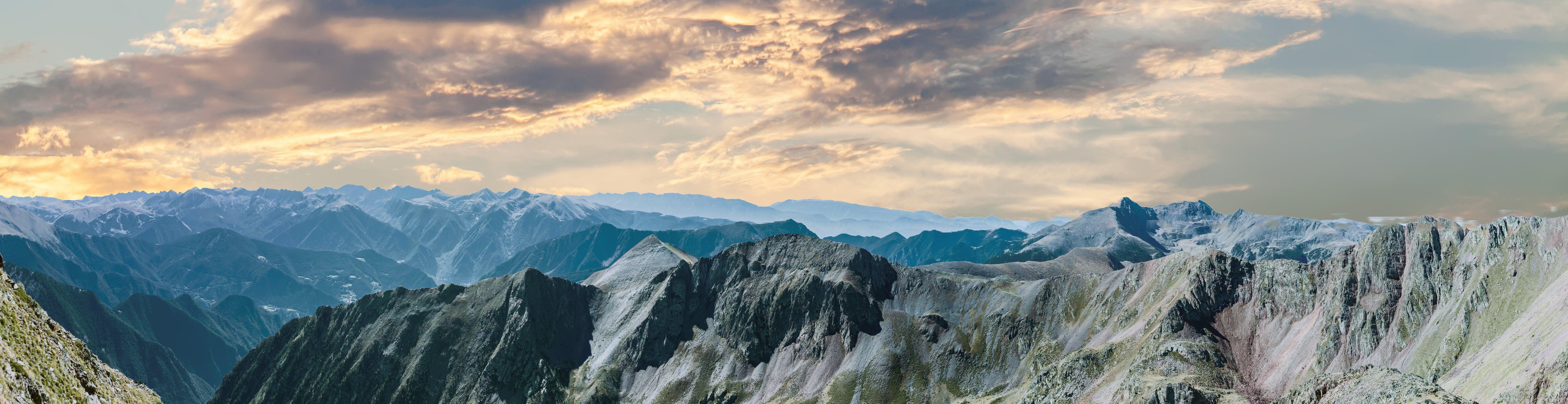 Mountain Ranges Under Dark Clouds
