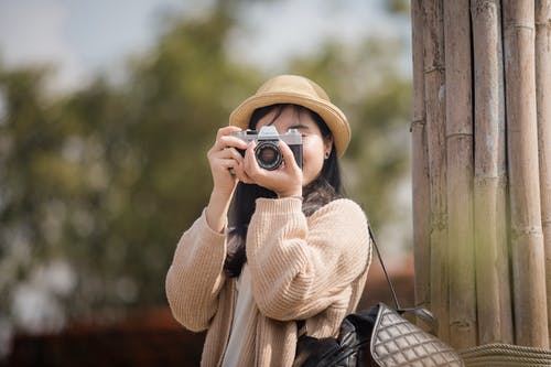 Woman Holding Dslr Camera