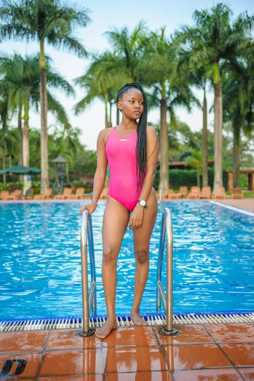 Girl in Pink Swimsuit Near Swimming Pool