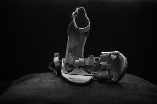 Grayscale Photo of Pair of Ankle Strap Open Toe Shoes