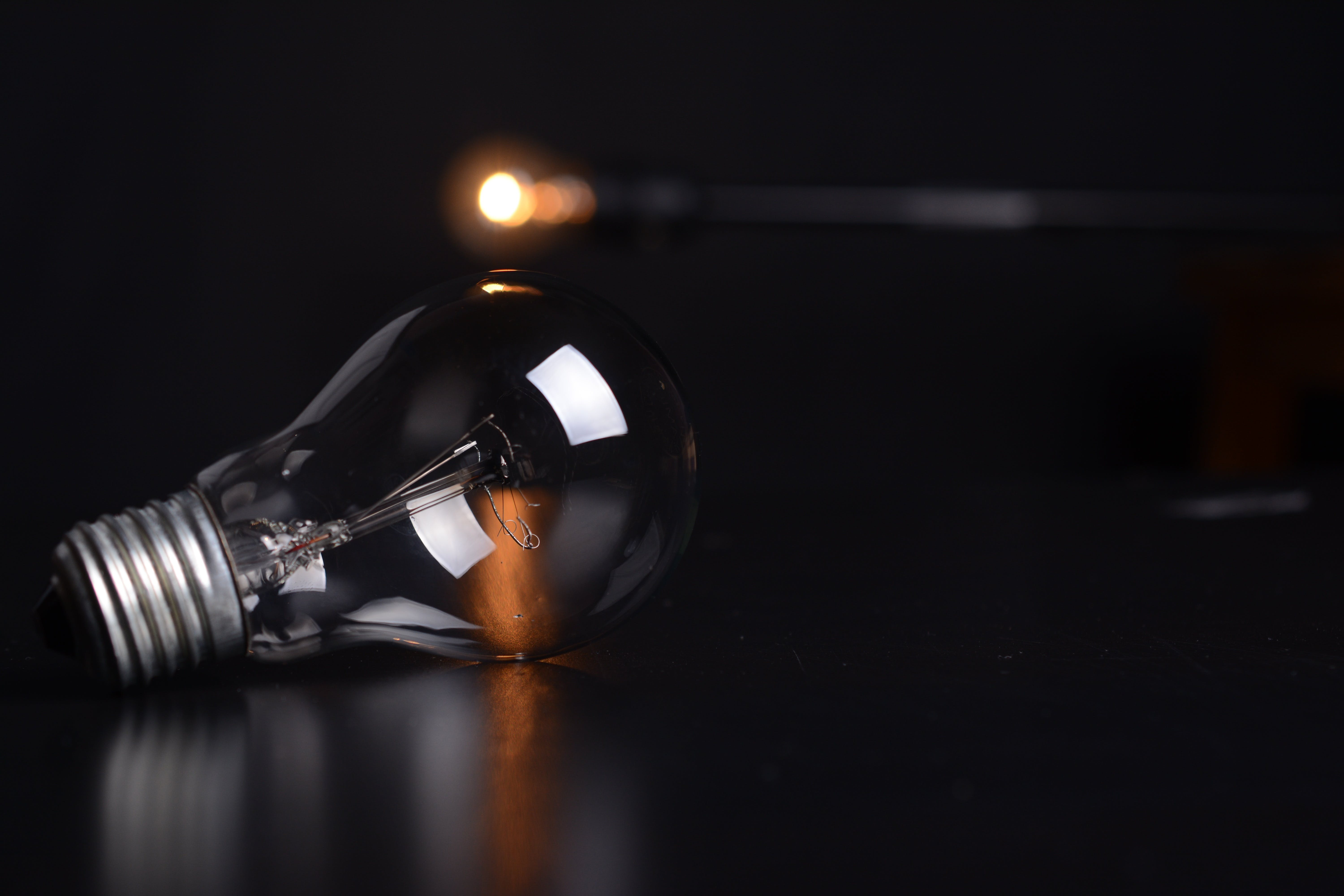 Clear Filament Bulb on Black Pad