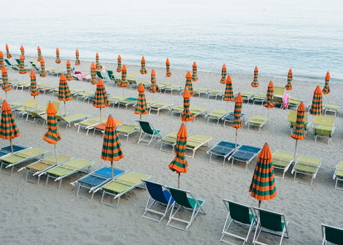 Parasols and Beach Chairs on Sand Near Sea