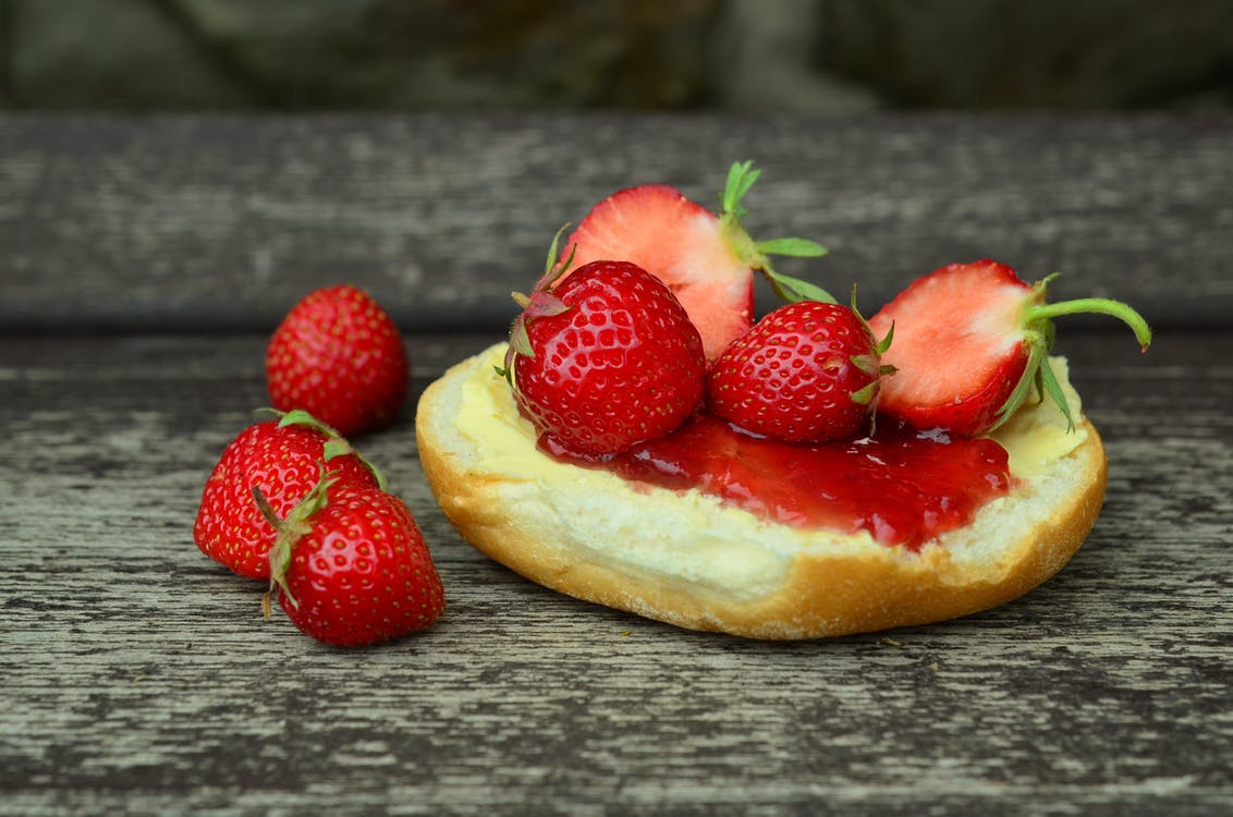 Close-up Photo of Strawberries on Bun