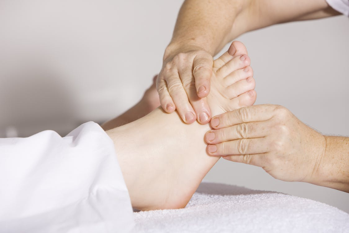 Person Massaging Foot