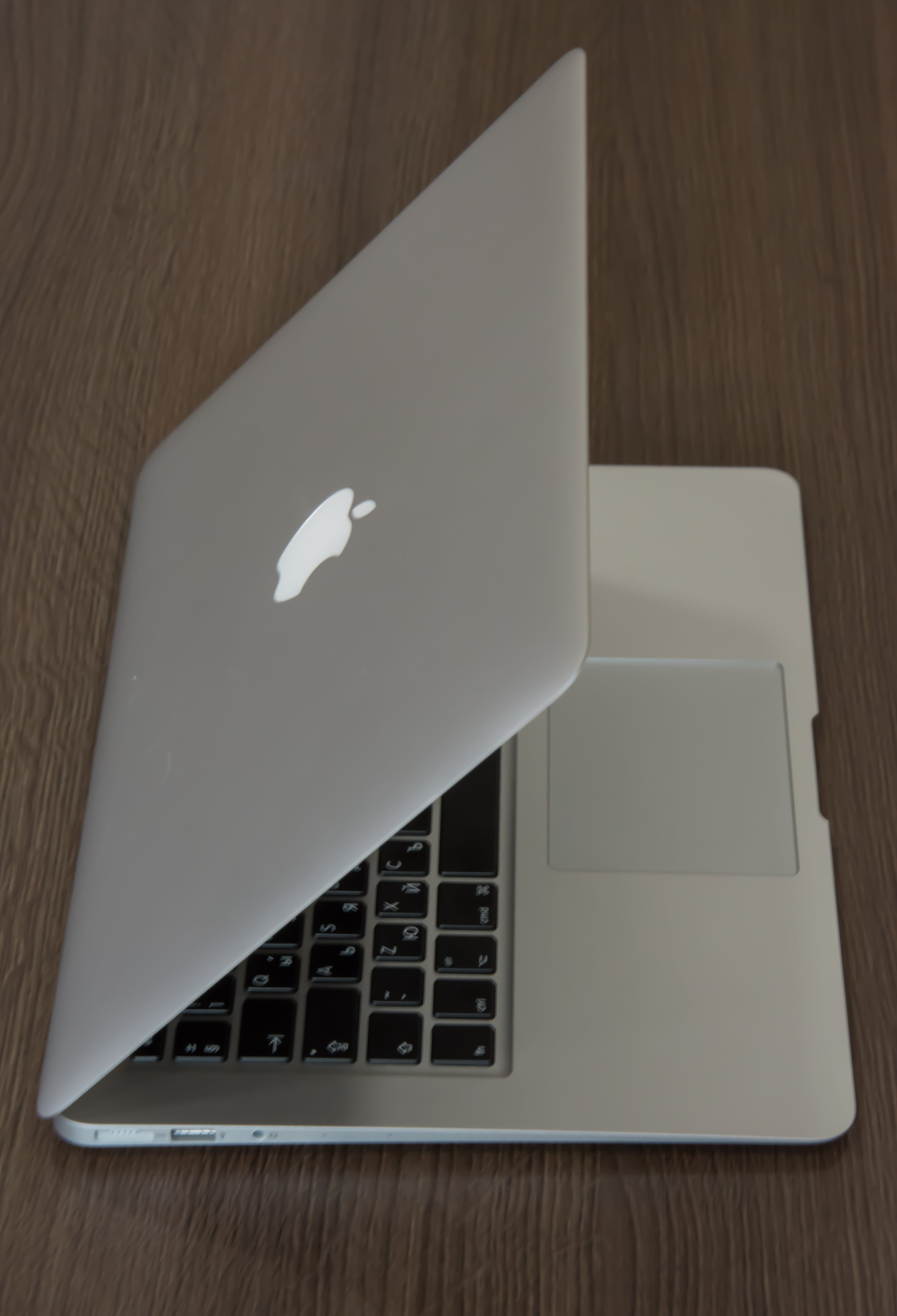 Silver Macbook on Brown Surface