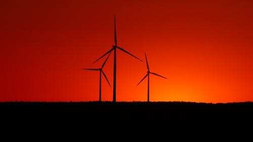 Silhouette of Three Wind Tubines