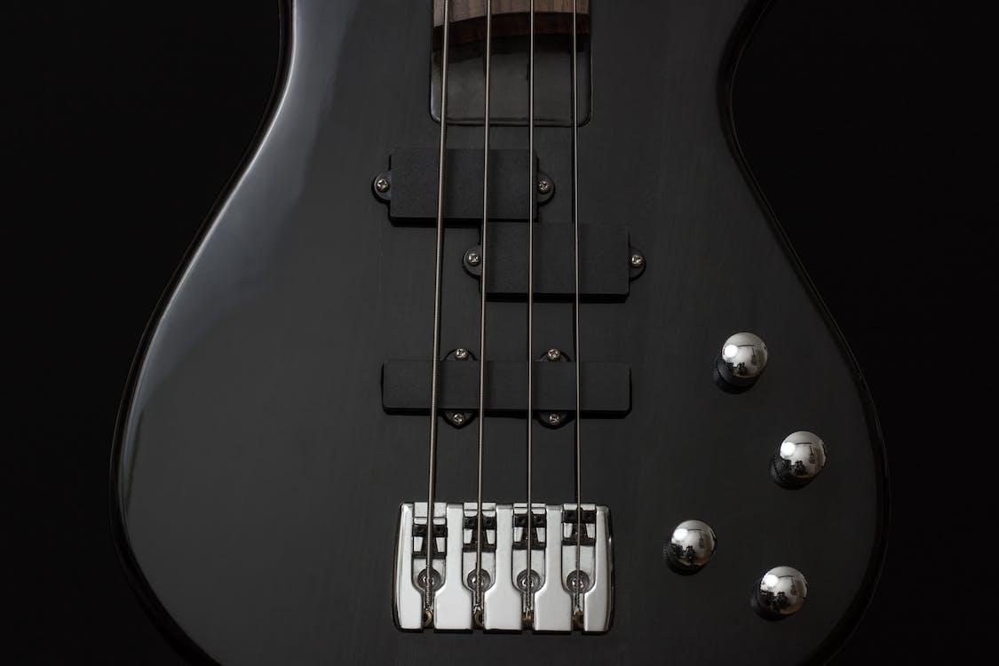Black 4 Stringed Guitar