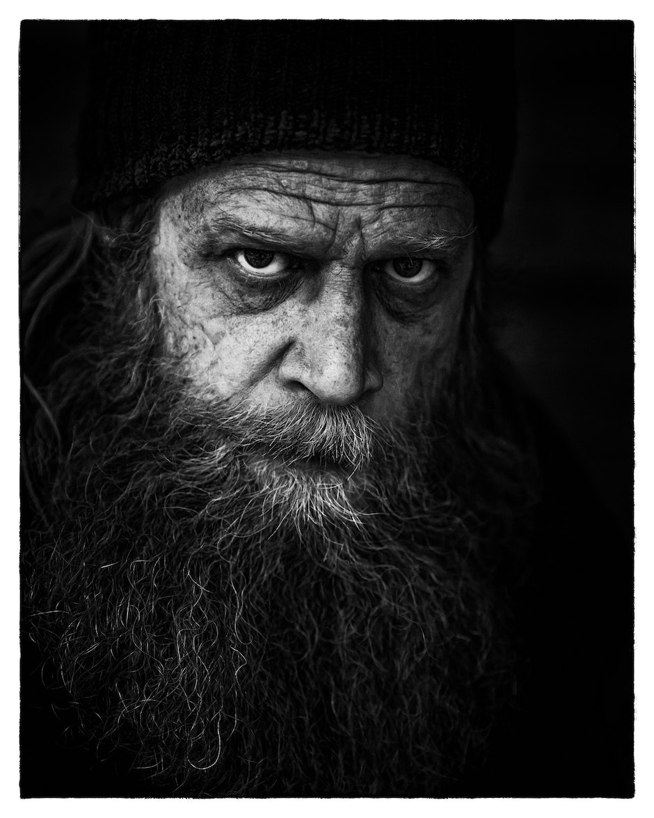 Man's Face in Grayscale Photography