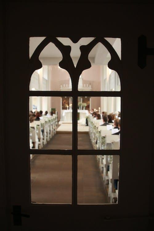 Free stock photo of church, church pews, door
