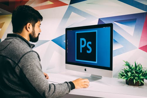 Man Using Photoshop Software