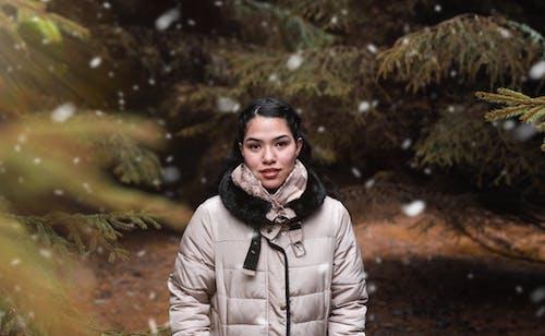 Woman Wearing White Puffer Jacket