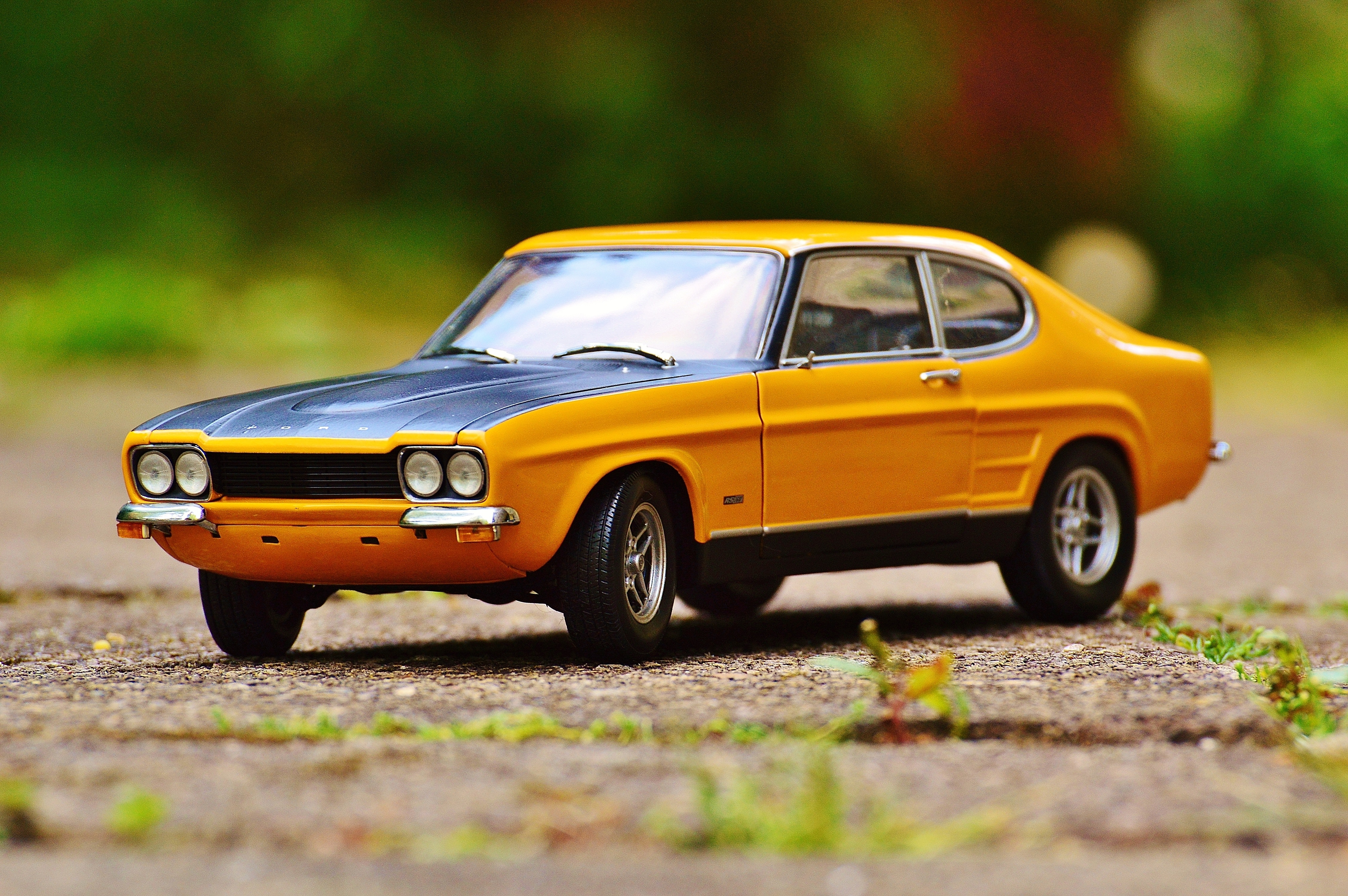 Yellow And Black Muscle Car In Tilt Shift Photography Free Stock Photo