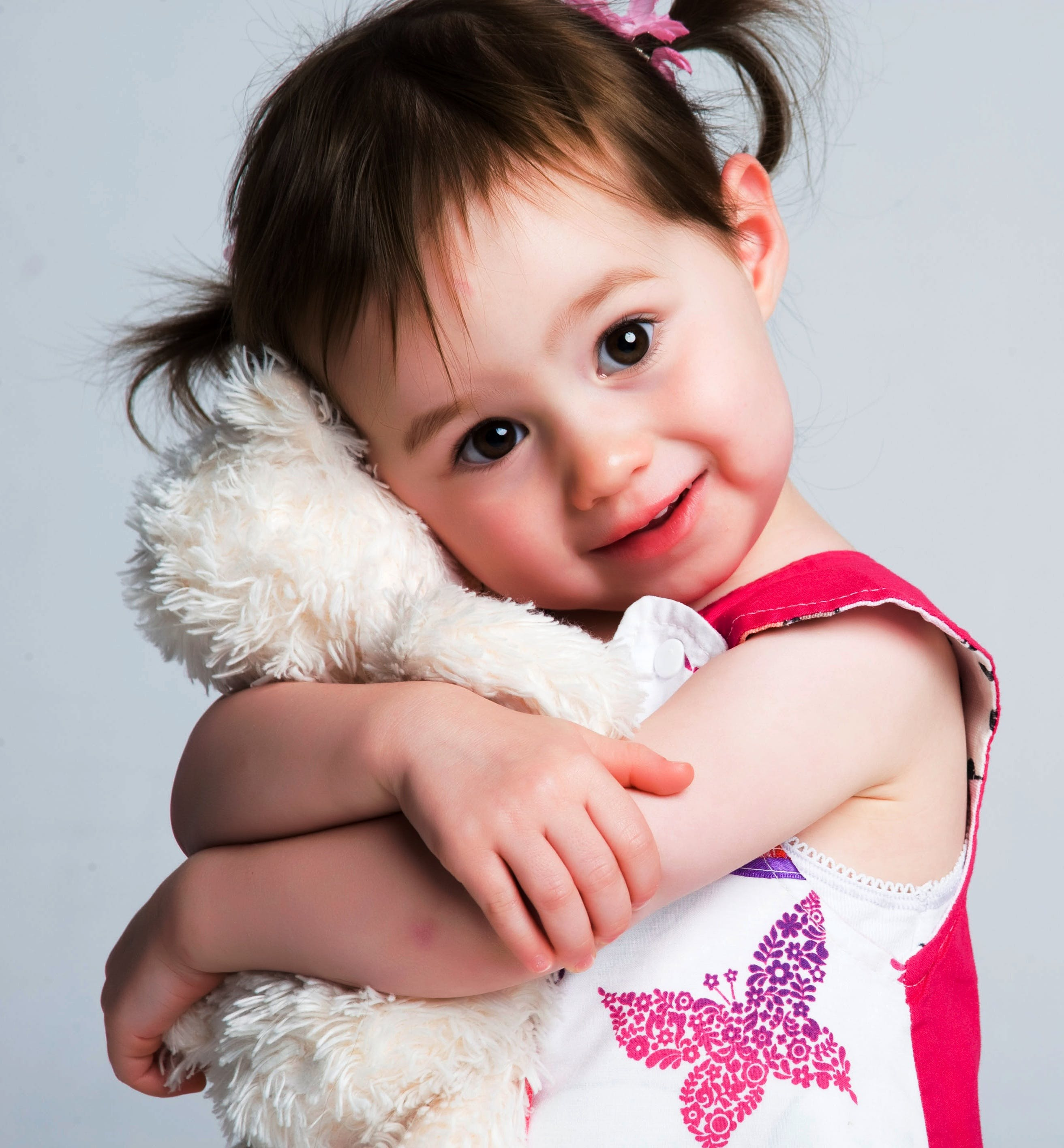 Girl Hugging Plush Toy