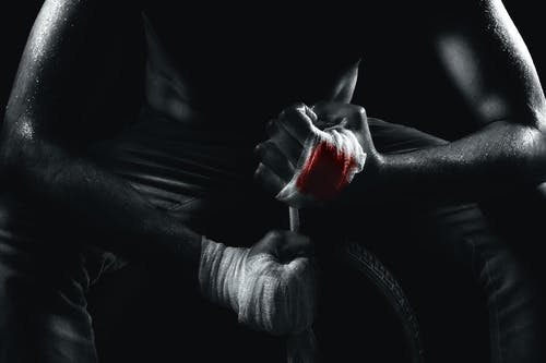 Free stock photo of black and white, black background, fight, hand