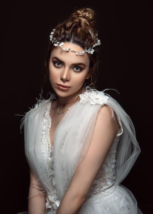 Woman Wearing White Tank Dress With White Headdress