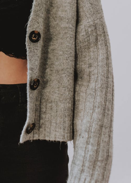 Woman Wearing Gray Button-up Wool Sweater