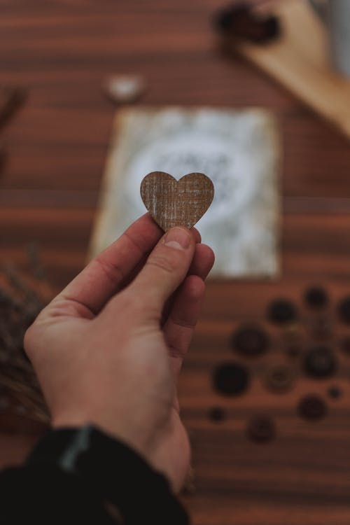 Shallow Focus Photo of Brown Heart Shaped Ornament