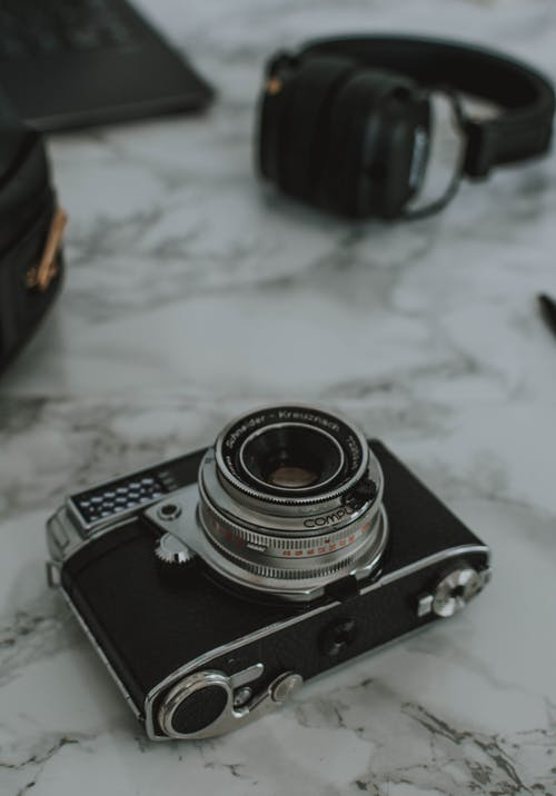 Black and Gray Camera on White Marble Surface