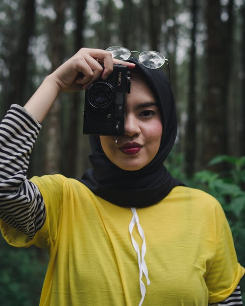 Free stock photo of analog camera, asian woman, black camera, camera