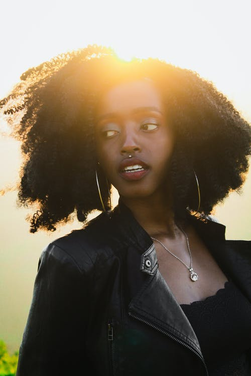 Free stock photo of african woman, Beautiful sunset, black hair, black leather jacket