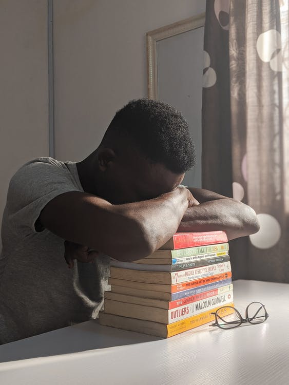 Man Napping on Books