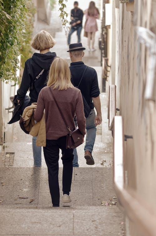 People Walking in a Narrow Road