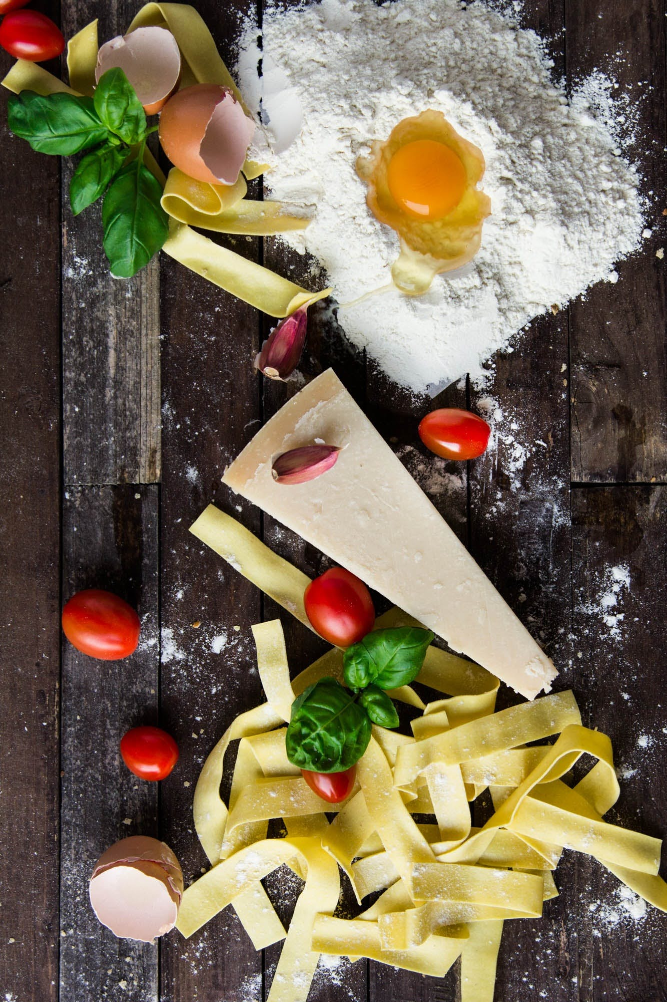 Pasta Tomatoes and Flour With Egg Shells on Table