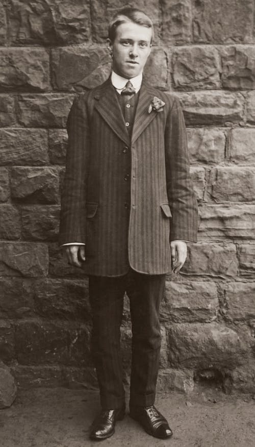 Grayscale Photo of Man in a Suit