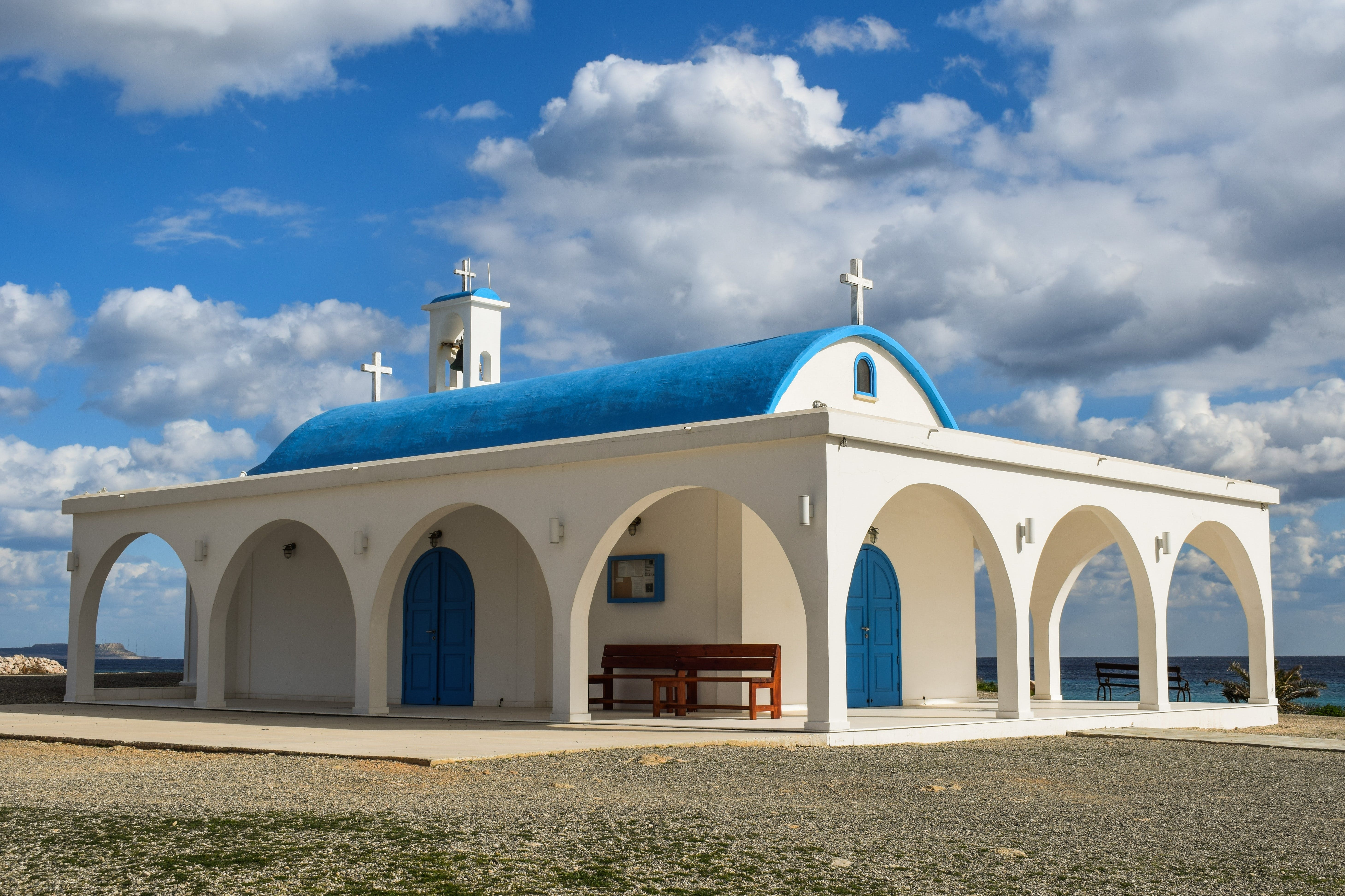 White and Blue Painted Church Under Blue Sky
