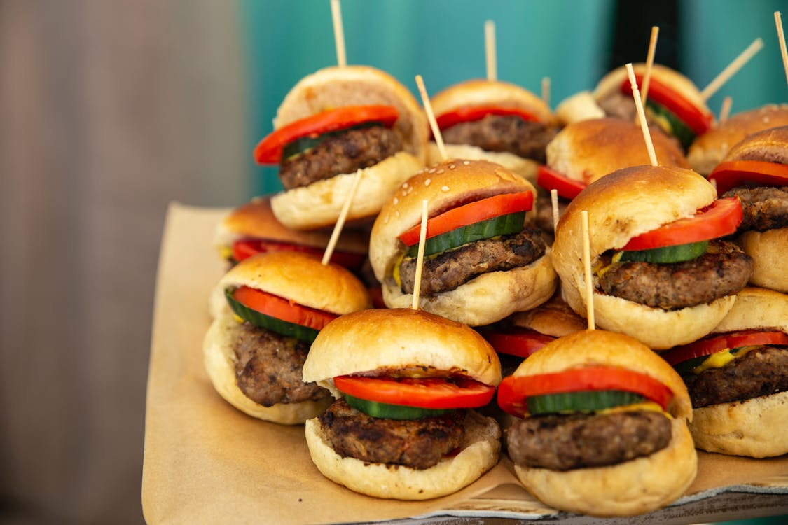 Selective Focus Photography of Pile of Burgers