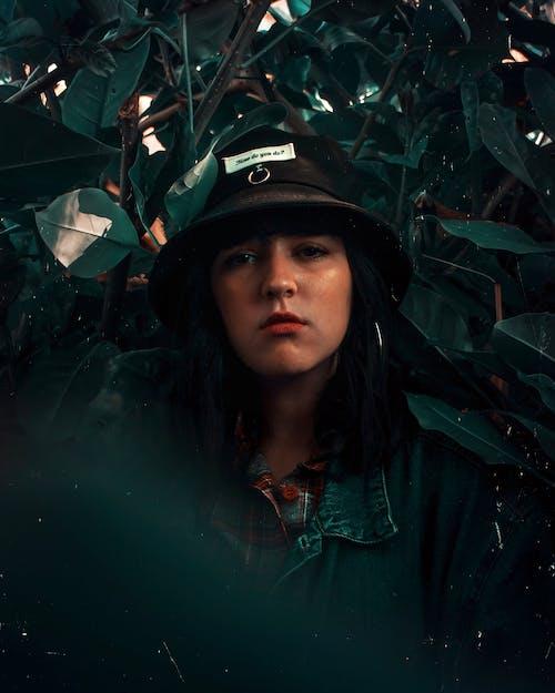 Woman Wearing Black Bucket Hat