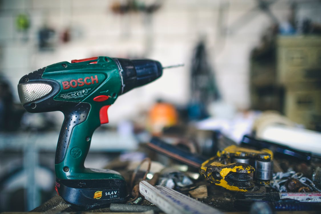Teal and Black Bosch Cordless Hand Drill