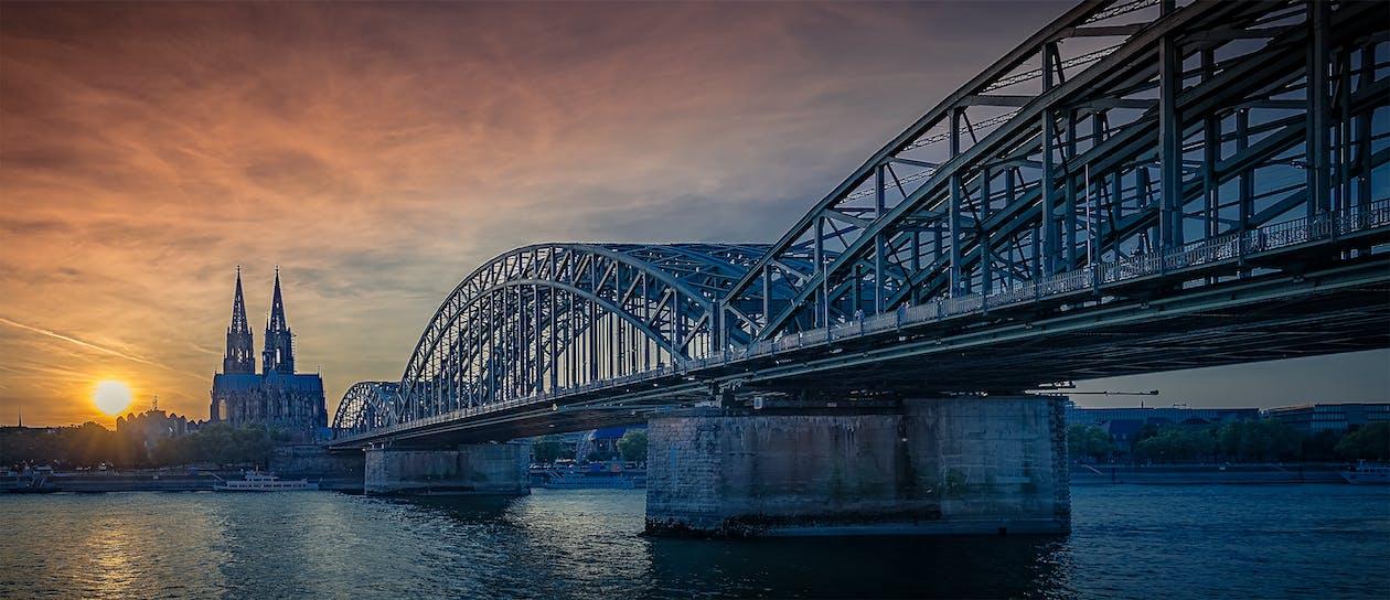 Gray Metal Bridge Heading City
