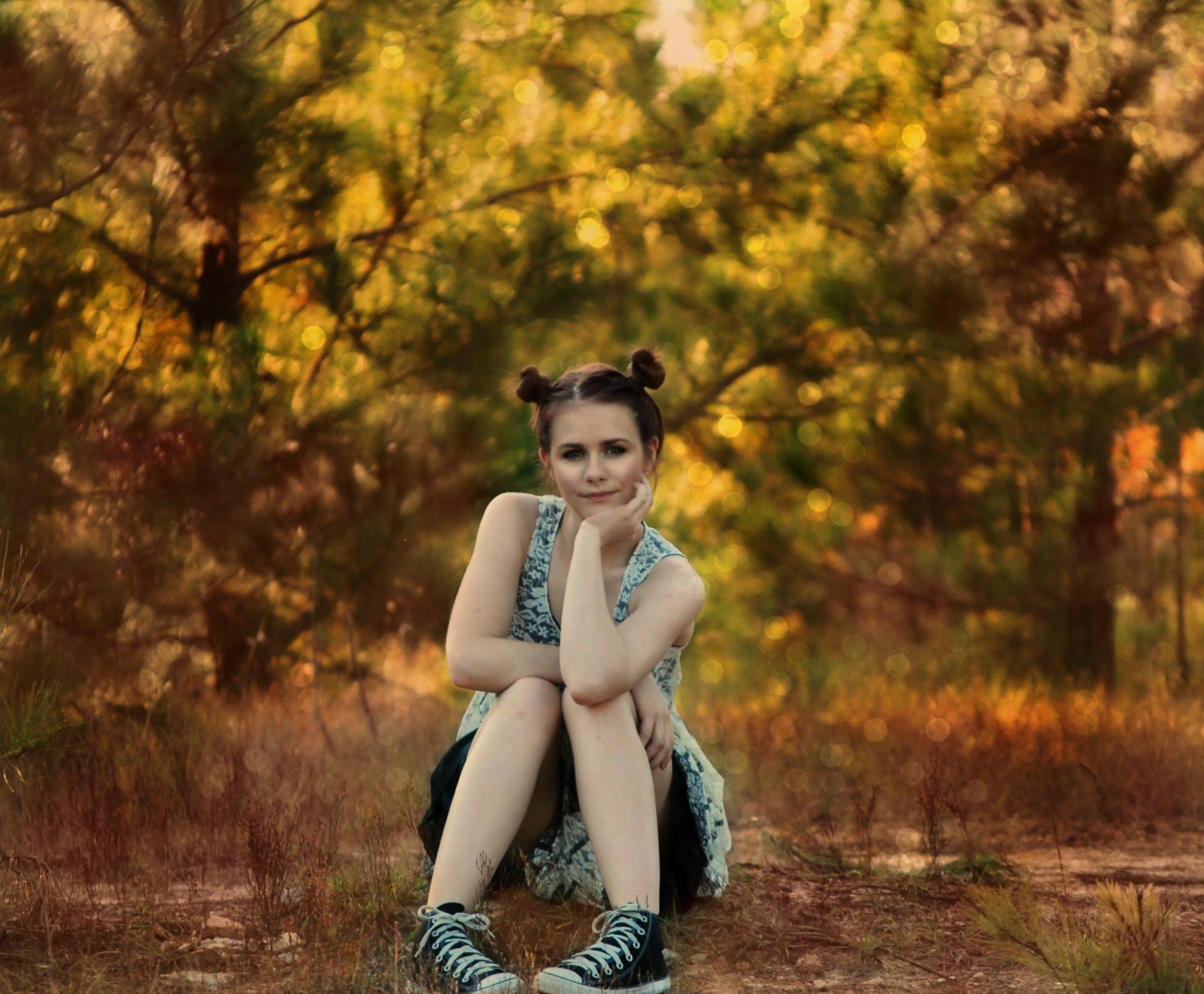 Girl Wearing Gray Dress Sitting on Ground