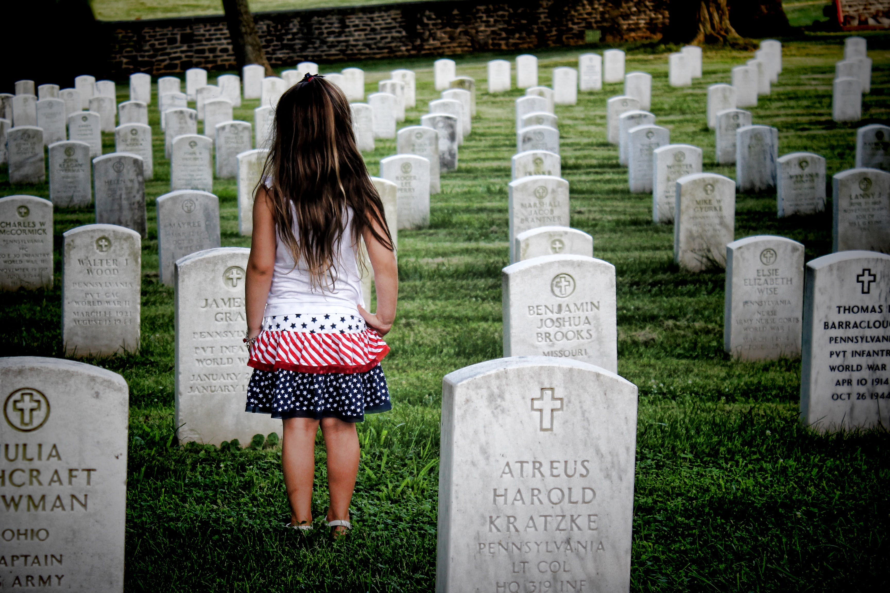 Girl Surrounded by Gravestones