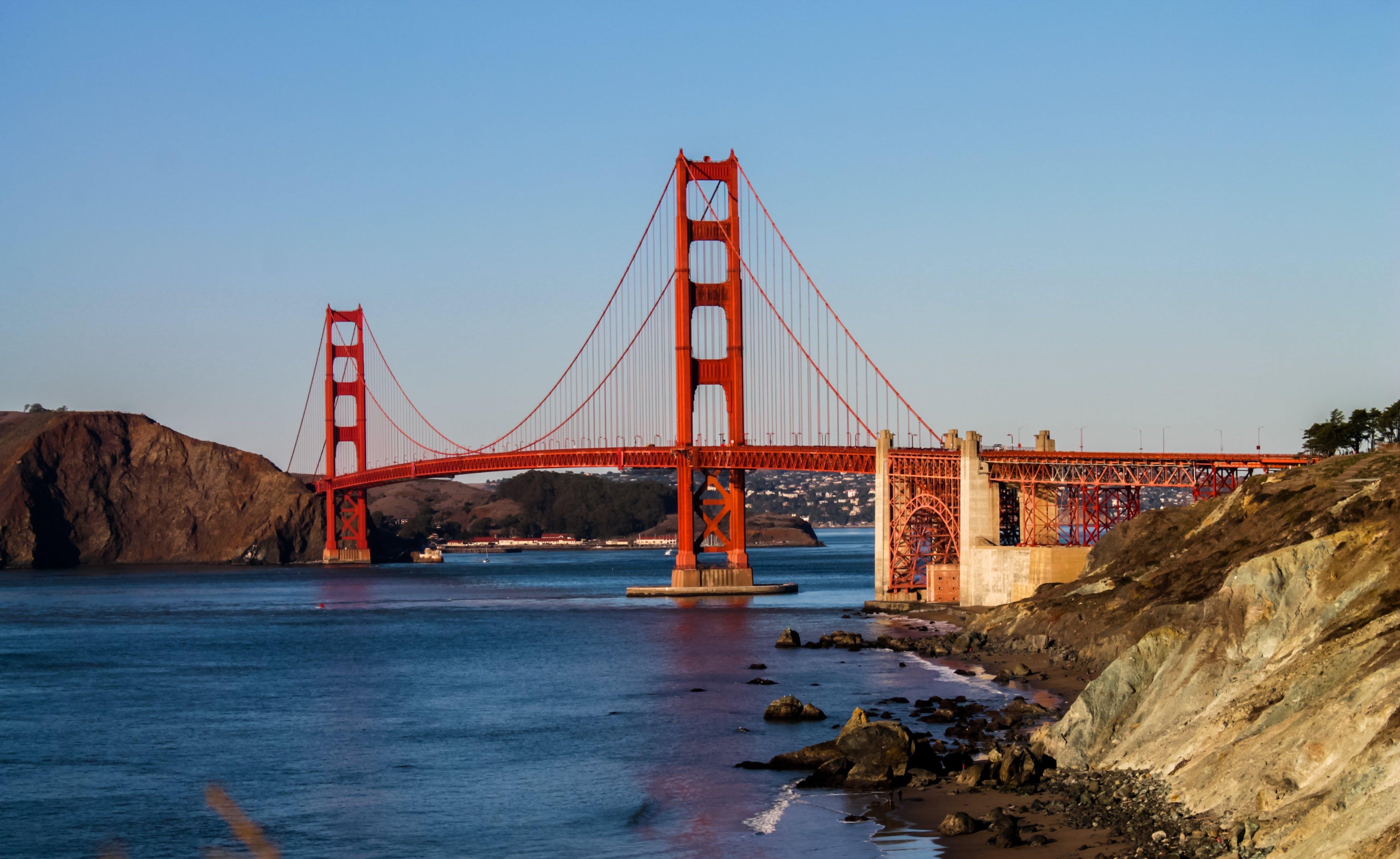 Photography of Bridge on Body of Water