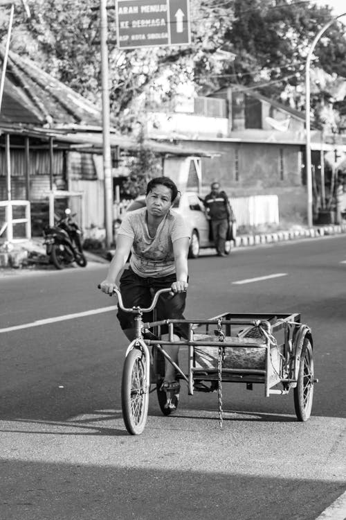 Grayscale Photography Of A Person  Riding Bicycle