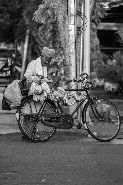 Man Selling Bananas On A Bike