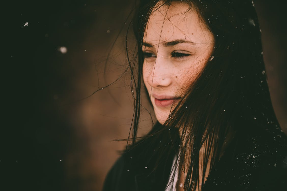 Portrait Of A Woman  With Snow Falling
