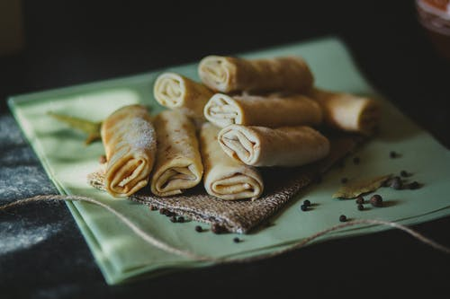 Spring Rolls on Piece of Fabric