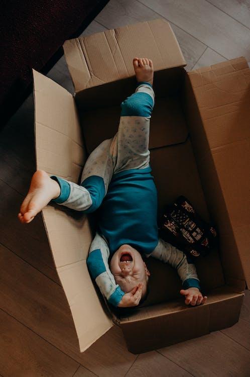 Little Boy Crying Inside A Box