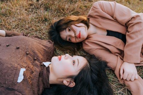 Two Women Lying on Grass