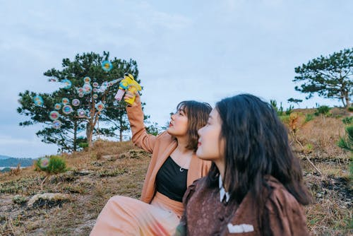 Two Women With A Soap Bubble Toy