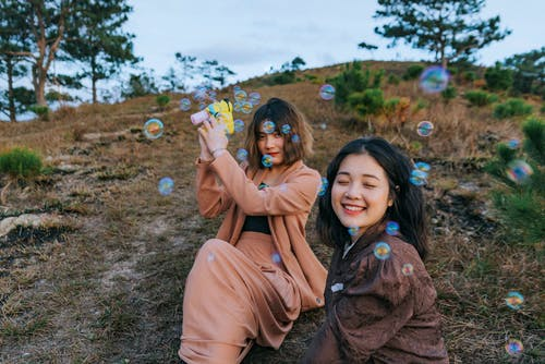 Photo of Women Playing With Bubbles
